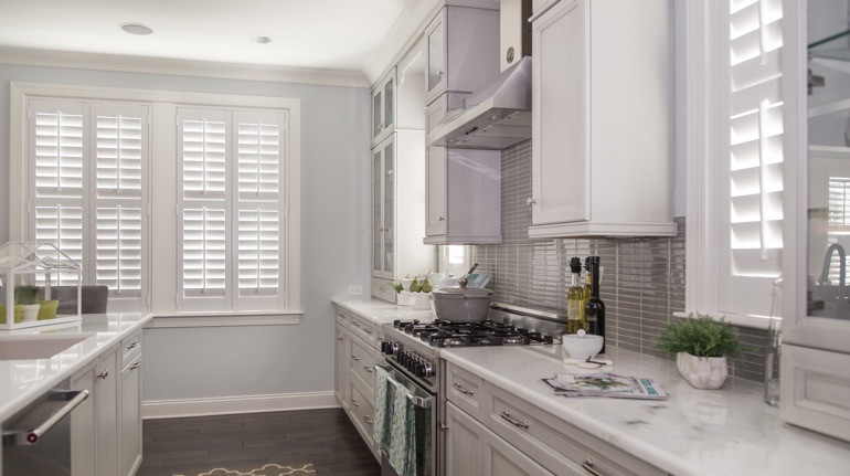 Polywood shutters in Jacksonville kitchen with marble counter.