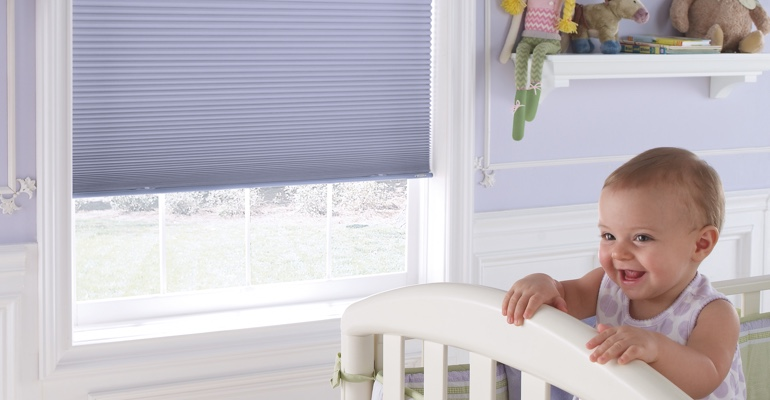 Jacksonville infant's room with honeycomb shades.