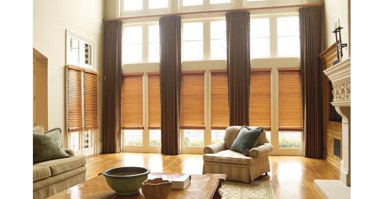 Jacksonville great room with wooden blinds and floor to ceiling drapes.