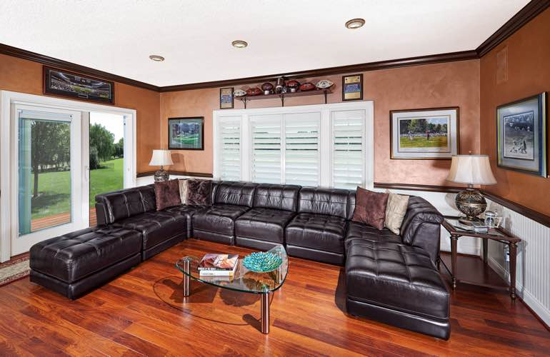 Jacksonville basement with sliding doors and plantation shutters.