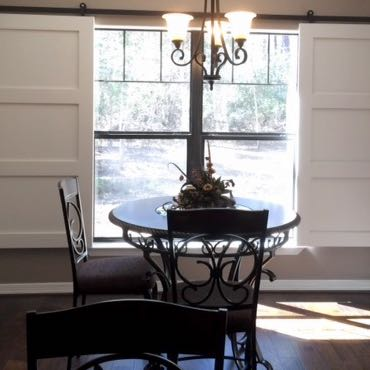 Jacksonville dining room barn door shutters.