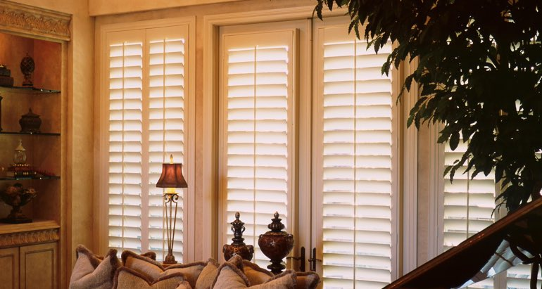 Plantation shutters on french door and window in Jacksonville parlor
