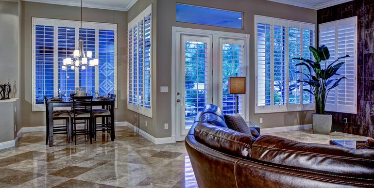 Jacksonville great room with plantation shutters and modern lighting.