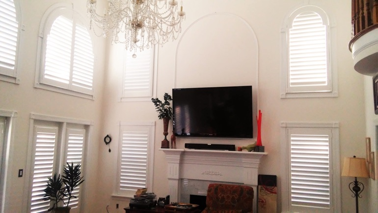 Jacksonville great room with wall-mounted television and arc windows.