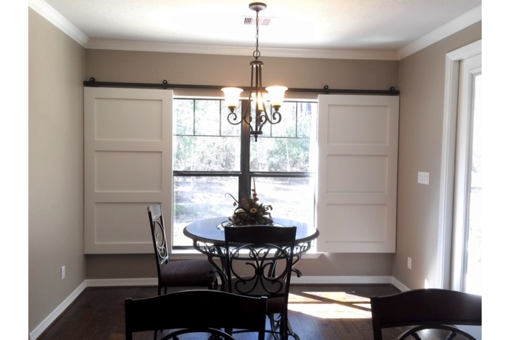 Jacksonville dining room with white barn door shutters.