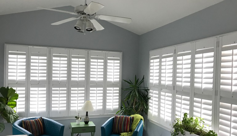 Jacksonville living room with fan and shutters