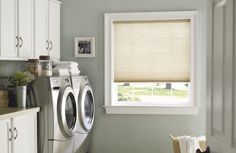 Jacksonville laundry room with pull-down window shades.