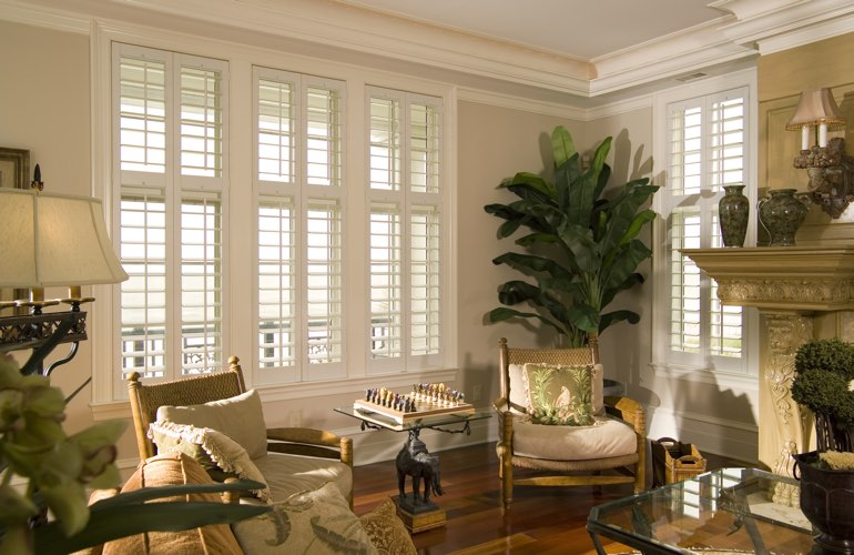 Living Room in Jacksonville with white plantation shutters.