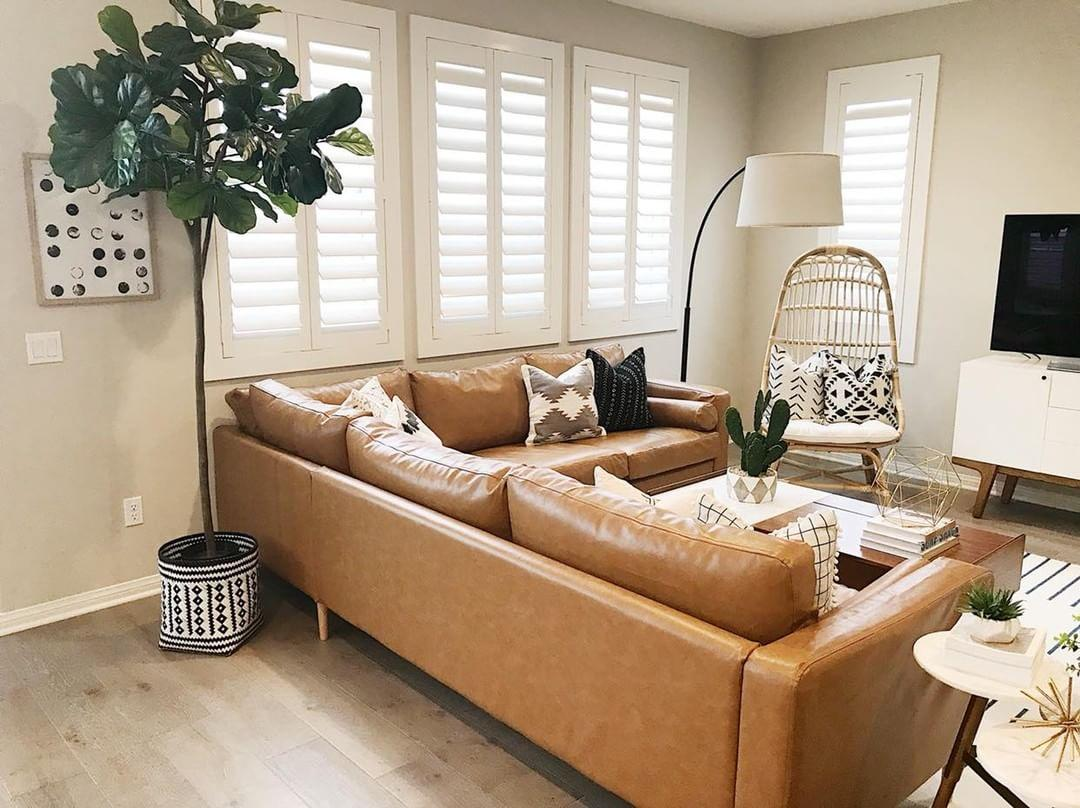 Comfortable living room with our Polywood shutters in Jacksonville.