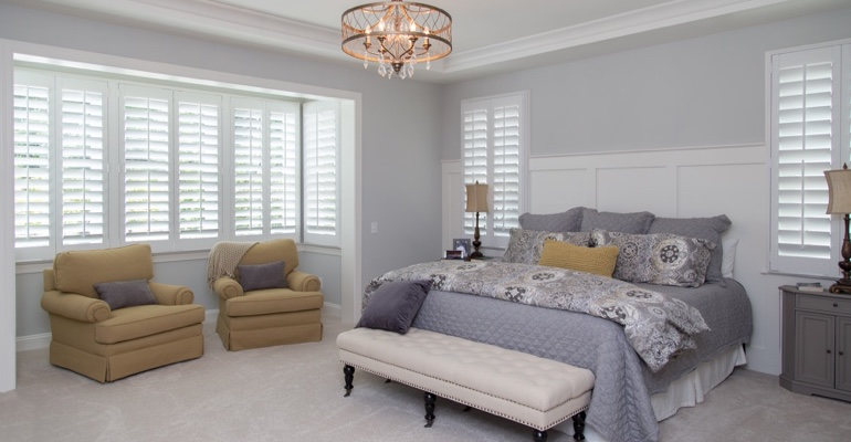 Plantation shutters in Jacksonville bedroom.