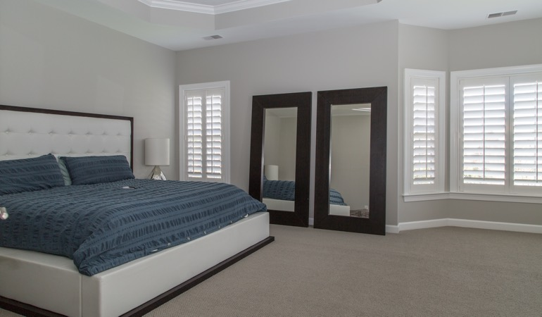 Polywood shutters in a minimalist bedroom in Jacksonville.
