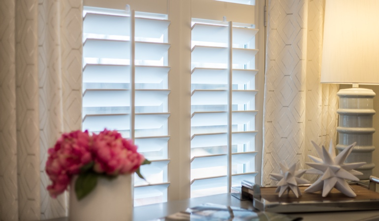 Plantation shutters by flowers in Jacksonville