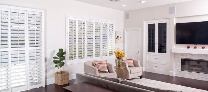 Jacksonville living room in white with plantation shutters.
