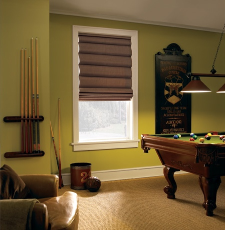 Roman shades in Jacksonville pool room with green walls.