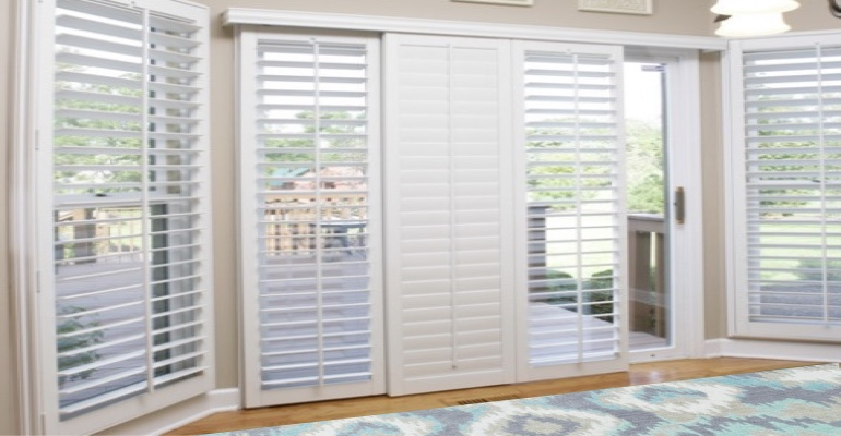 [Polywood|Plantation|Interior ]211] shutters on a sliding glass door in Jacksonville