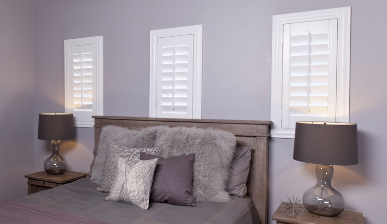 Studio plantation shutters in Jacksonville bedroom windows.