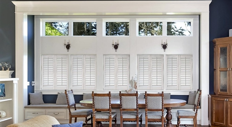 Jacksonville great room with white plantation shutters.