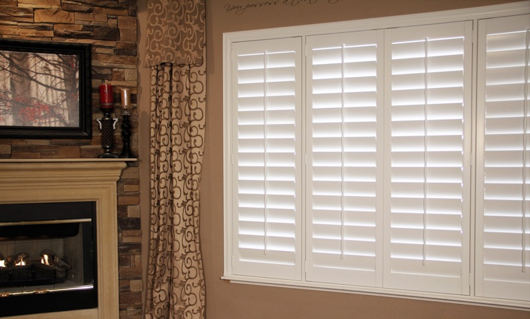 Jacksonville Studio plantation shutters in family room.