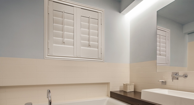White waterproof shutters in Jacksonville bathroom.