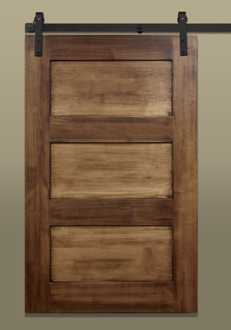 3-panel sliding barn door with a light stain and dark hardware