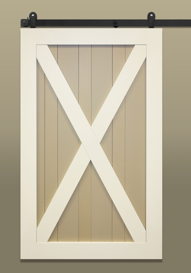 Light colored sliding barn door with X-brace