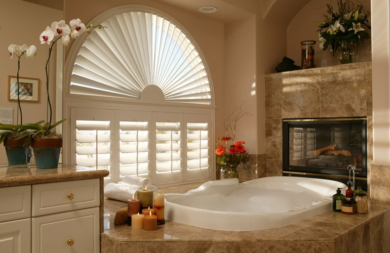 Arched shutters in a Jacksonville bathroom.