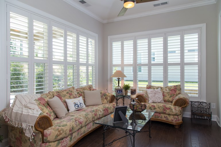 Traditional sunroom with faux wood shutters in Jacksonville.