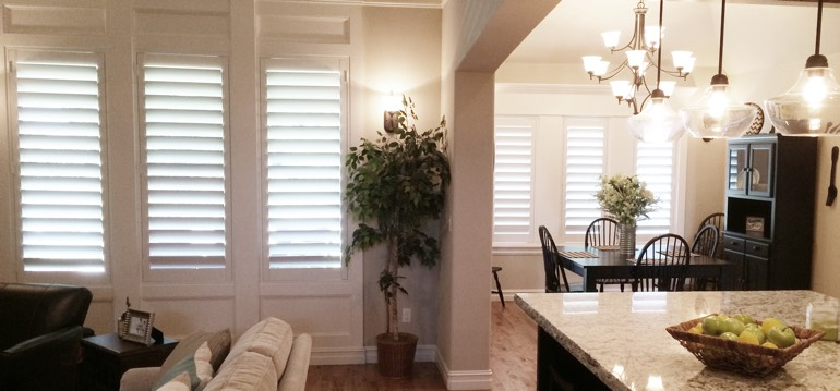 Jacksonville shutters in kitchen and living room