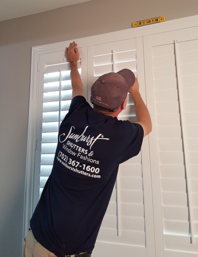 Shutter installation in Jacksonville bedroom.