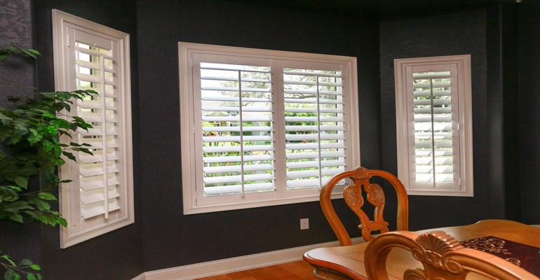White Polywood Shutters In Dark Green Dining Room