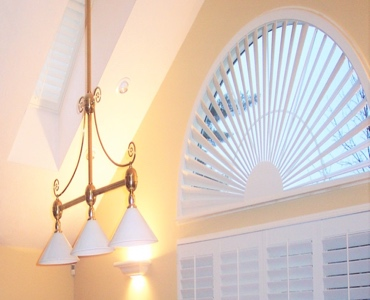 Jacksonville arched eyebrow window with plantation shutter