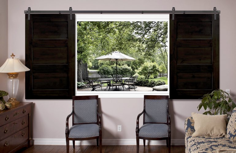 3 panel barn door shutters in living room