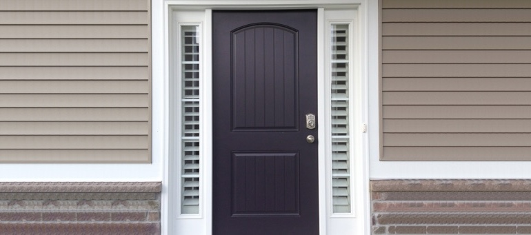 Entry Door Sidelight Shutters Next To Black Door In Jacksonville, FL