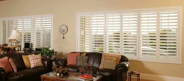 Wide window with white shutters in Jacksonville living room